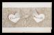 een romantische kaart met 2 harten bij elkaar gehouden met een luxe strik
