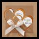 Trouwkaart met hartjes in koperfolie en echte strik