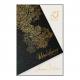 Glinsterend zwart papier met een sierlijk goud patroon en inlegvel.